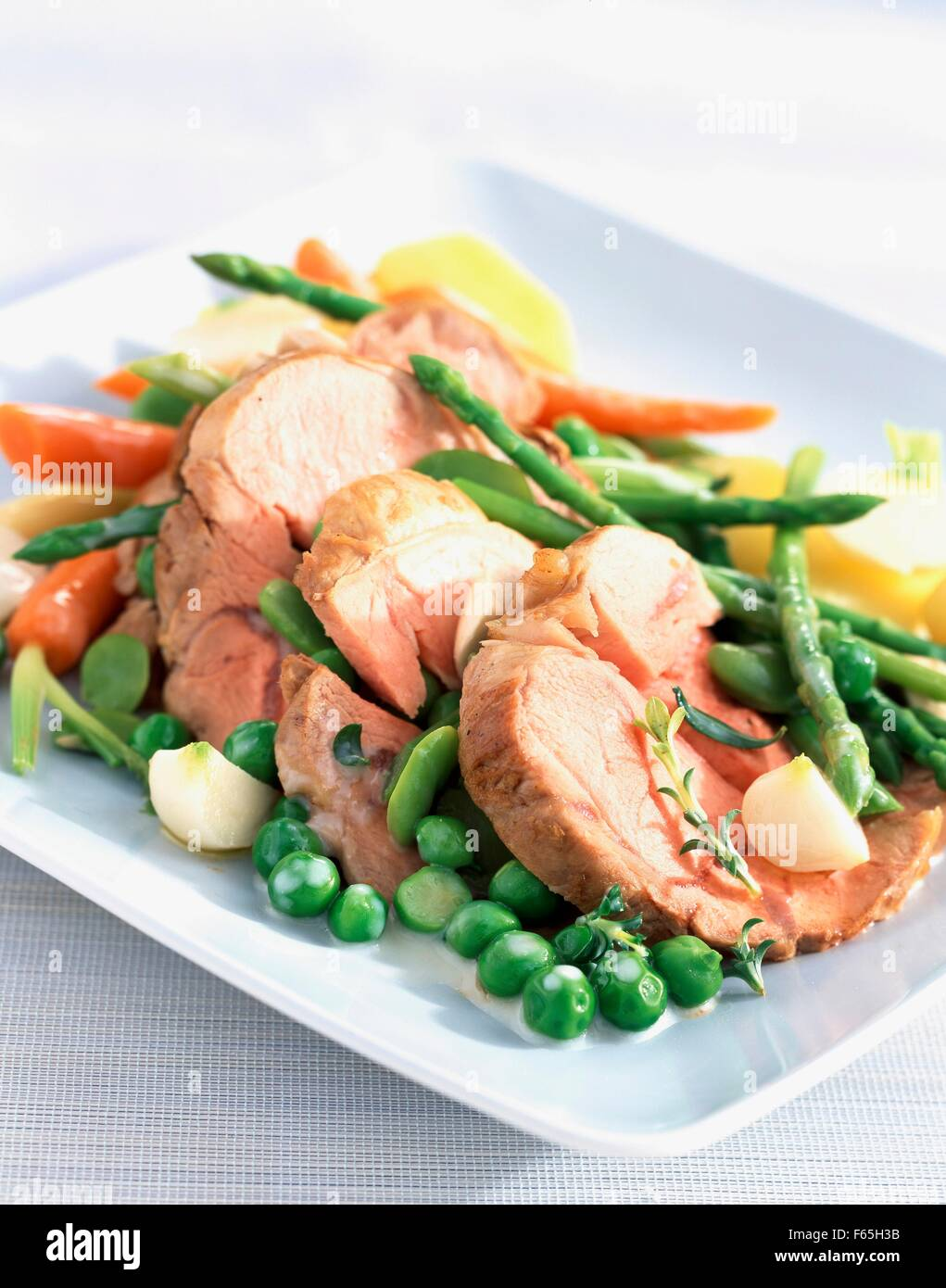 Roast veal with spring vegetables - Stock Image