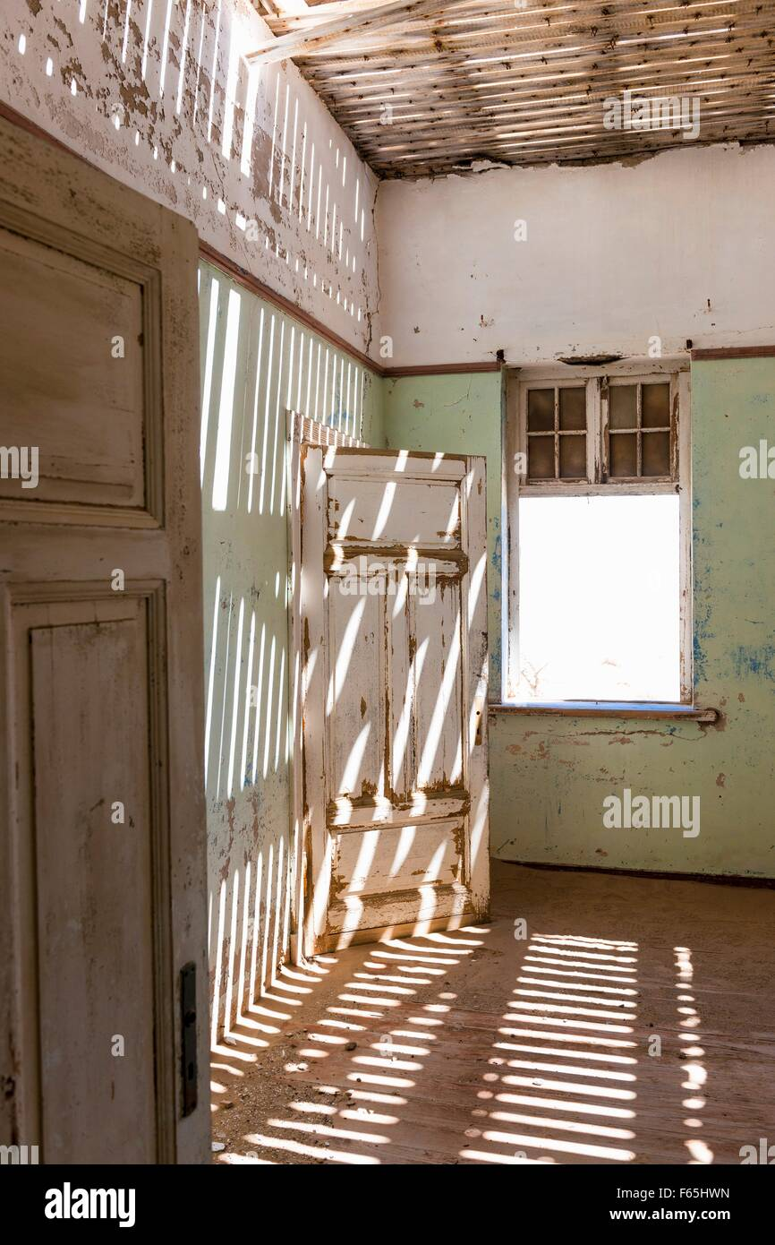 An abandoned house in Kolmannskuppe, Namibia, Africa – years ago the place was overrun by diamond prospectors, today - Stock Image
