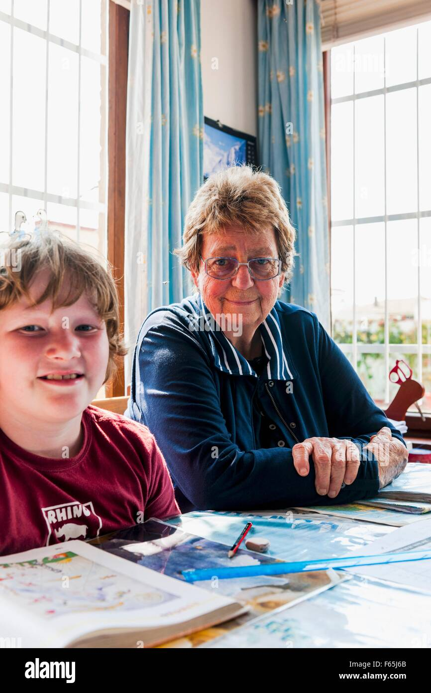 Mrs Hinz looking after children with homework, Swakopmund, Namibia, Africa - Stock Image