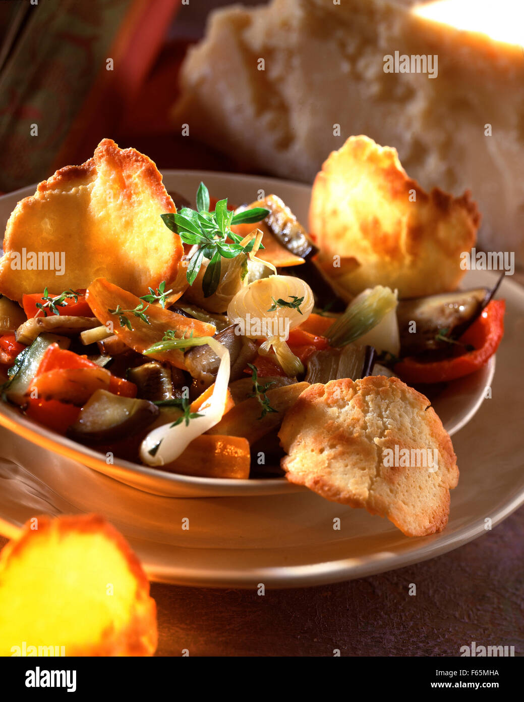 Stewed vegetables with parmesan tuile biscuits Stock Photo