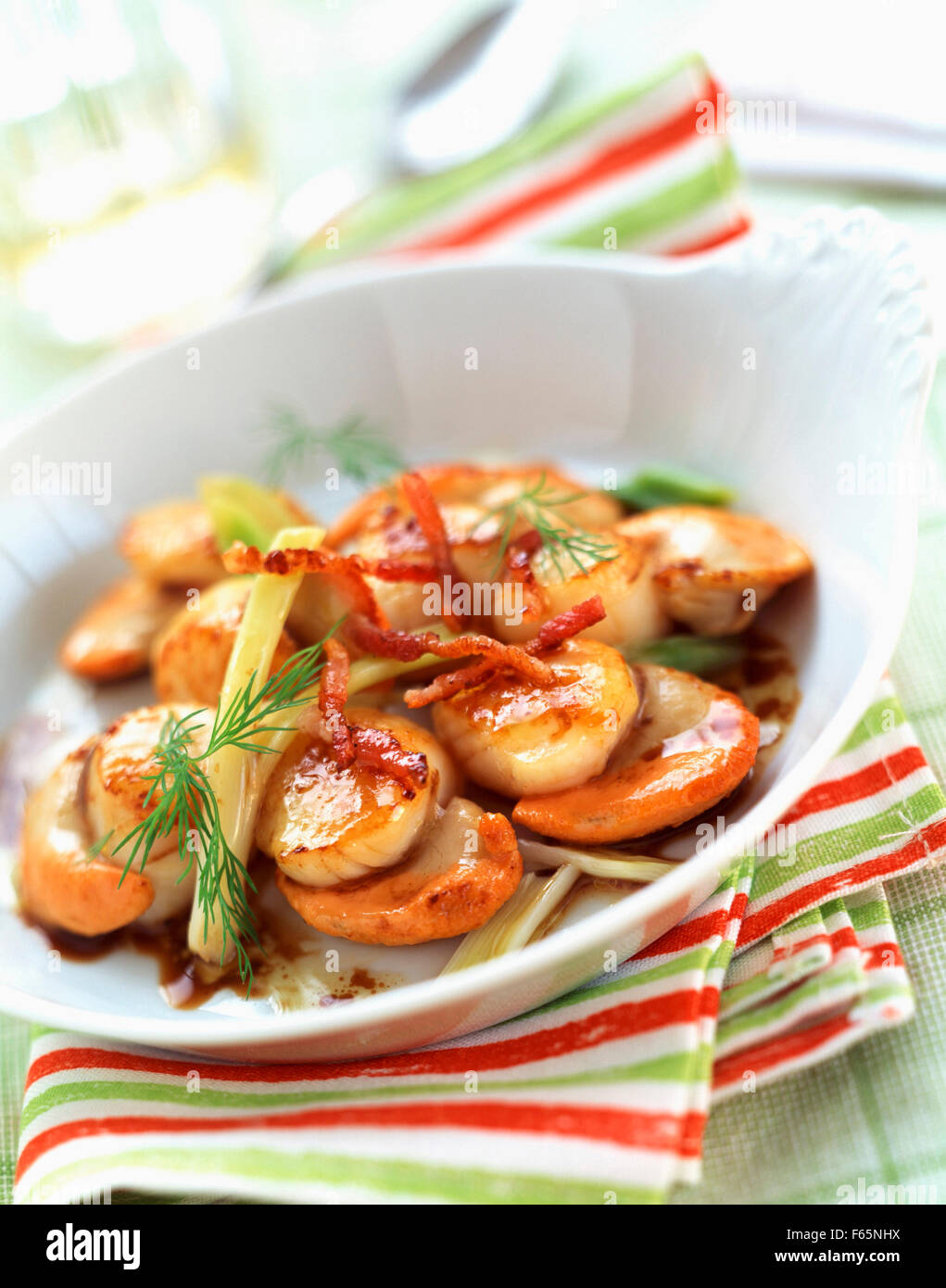 Sauteed scallpos with bacon and fennel Stock Photo