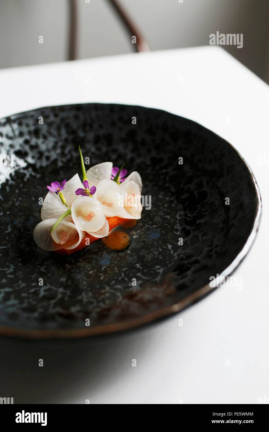 Scallops with radishes at the restaurant 'Oscillate Wildly' - Stock Image