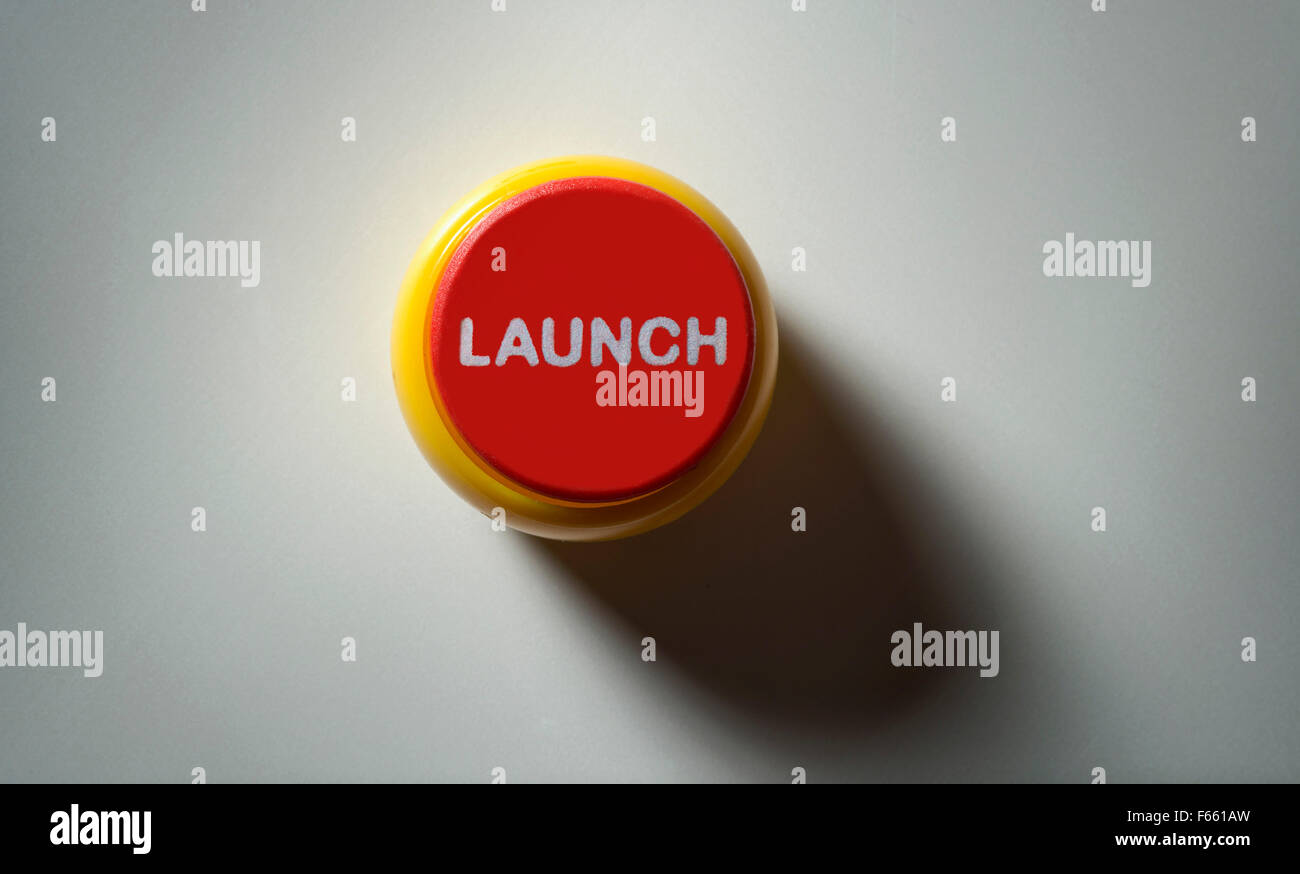 Concept picture of a red missile launch button,re nuclear deterrent response in the event of a war,attack or emergency.a - Stock Image