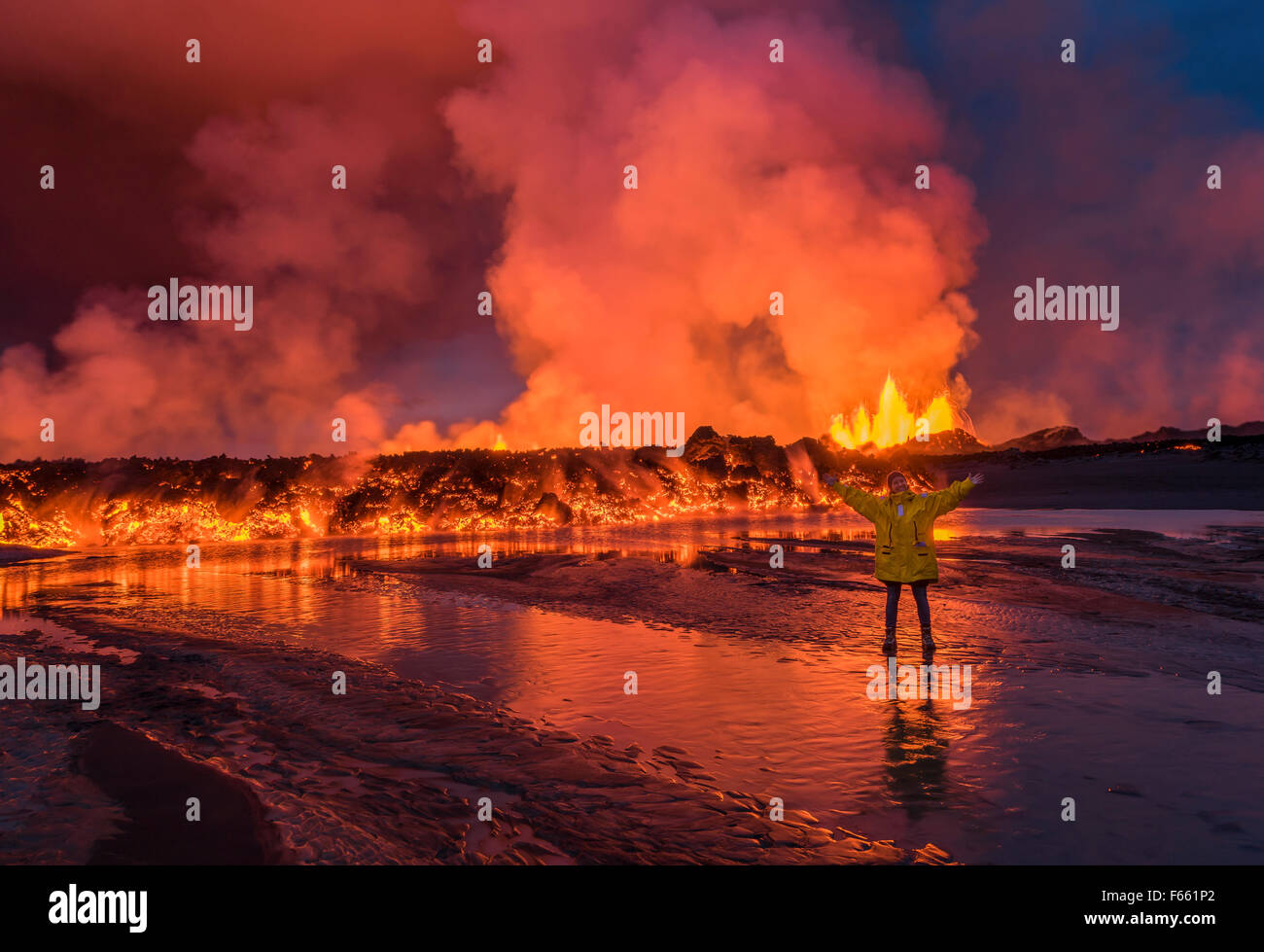 Woman excited by the lava flow at the Holuhraun Fissure eruption near Bardarbunga Volcano, Iceland - Stock Image