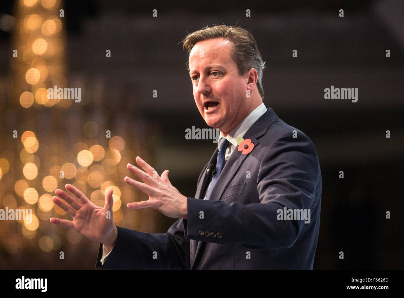 Prime Minister David Cameron talks to business leaders at the CBI conference in London Stock Photo
