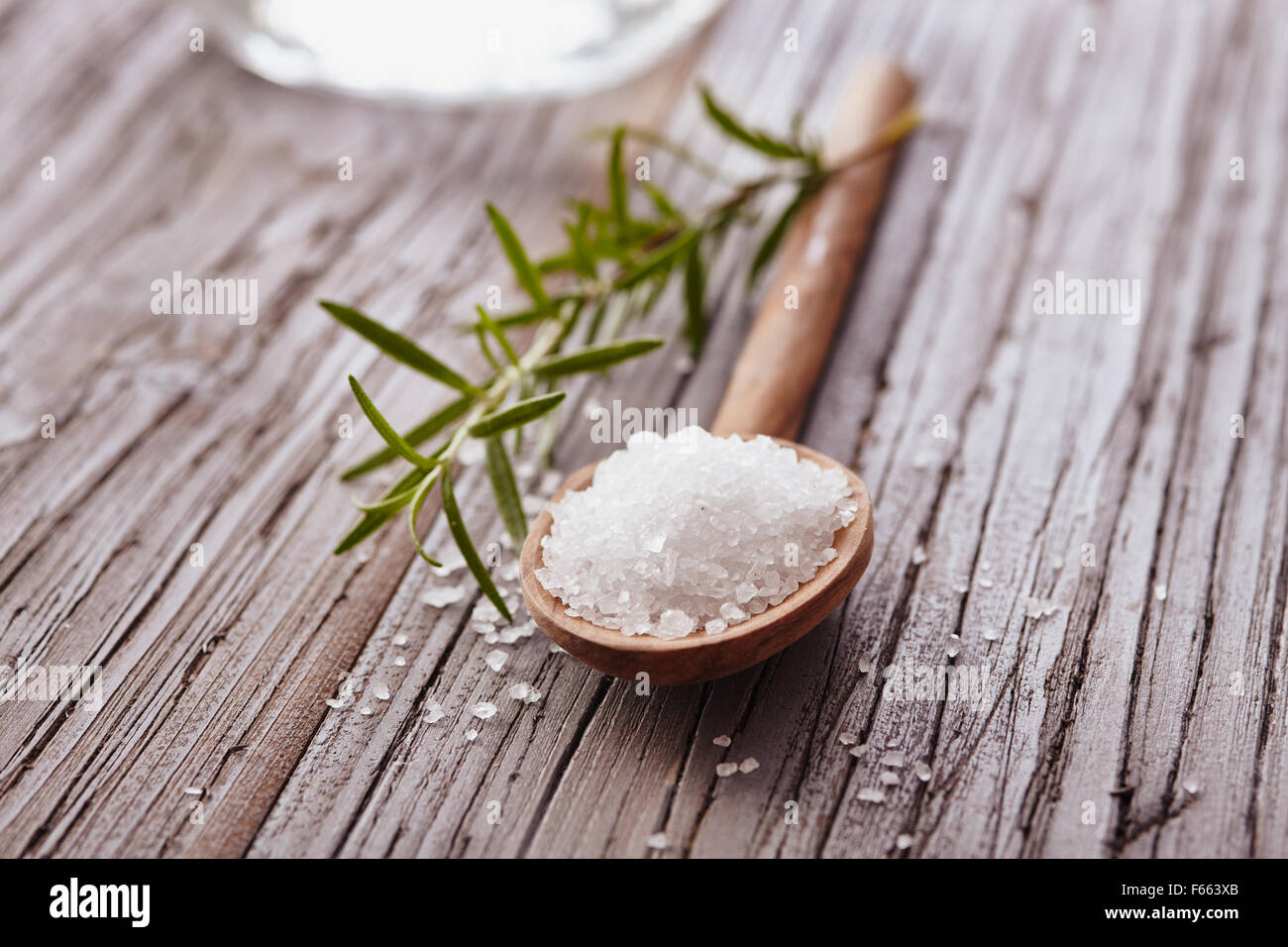 Salt crystals in a wooden spoon - Stock Image