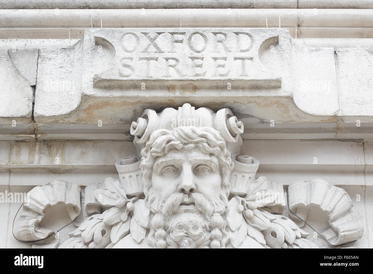 Ancient Oxford street sign in white stone in London - Stock Image