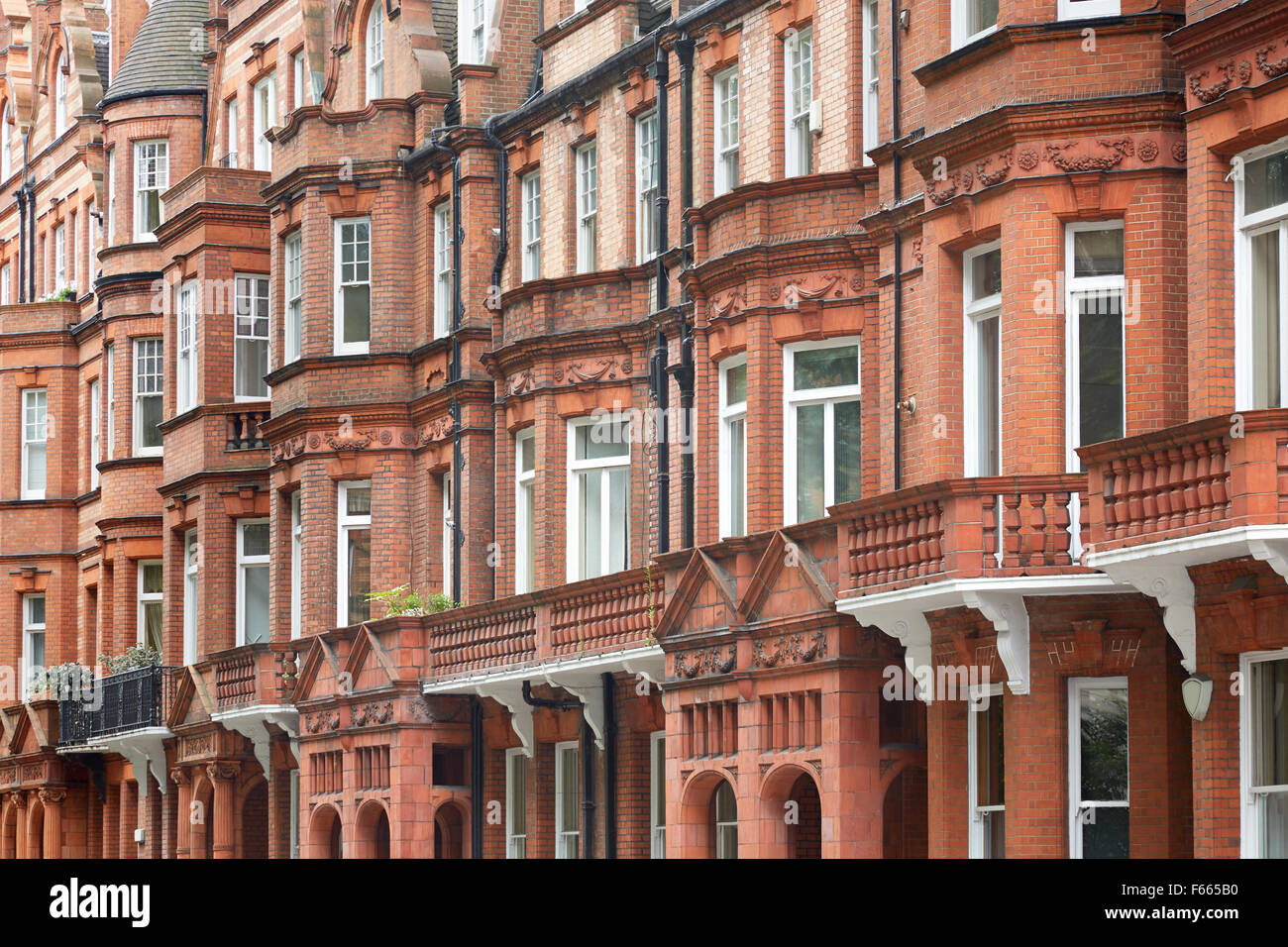 Red bricks English houses facade in London - Stock Image