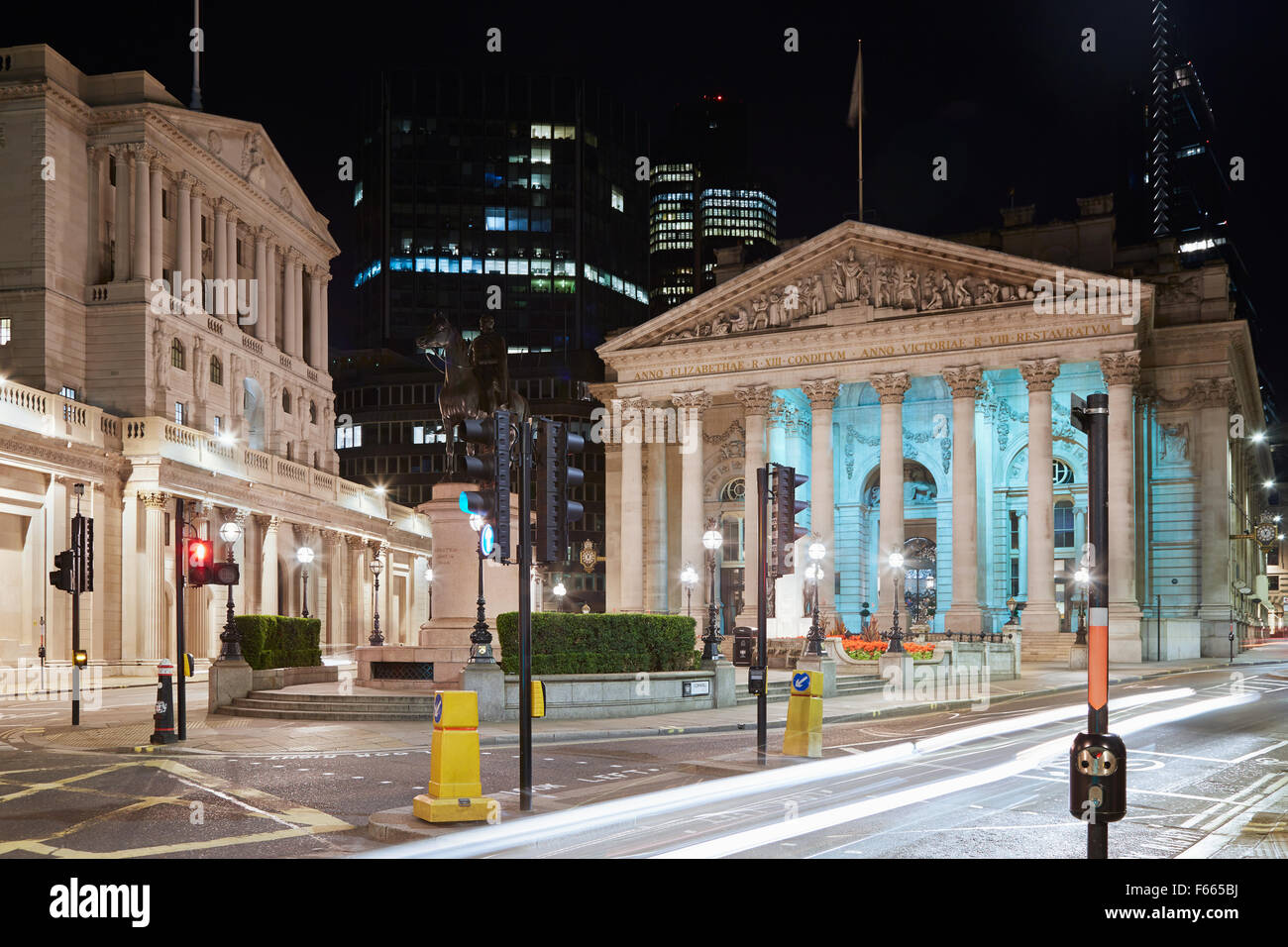 London Royal Exchange, luxury shopping center and Bank of England at night - Stock Image