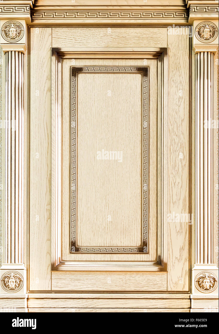 Wooden light decorated facade of furniture closeup - Stock Image