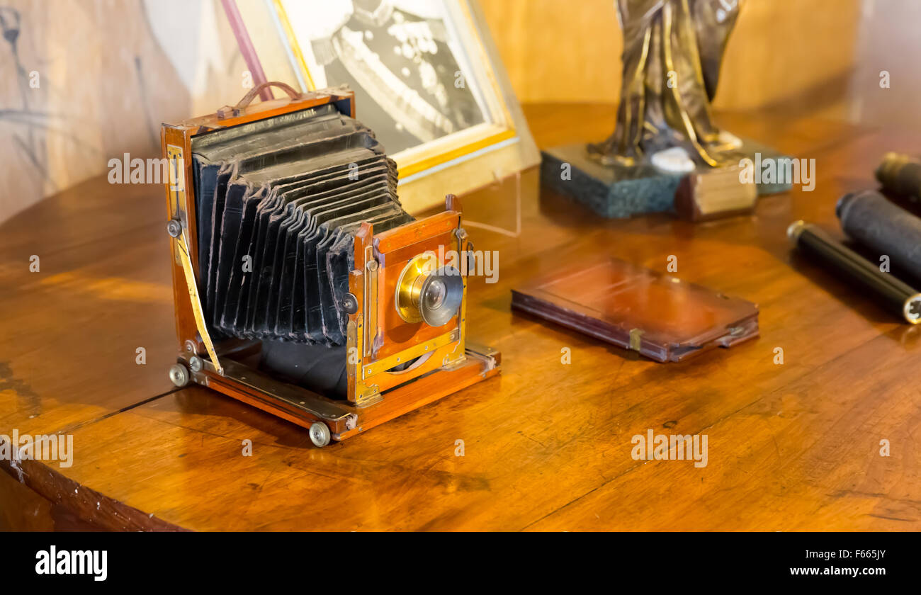 Retro photocamera on the wooden table close up - Stock Image