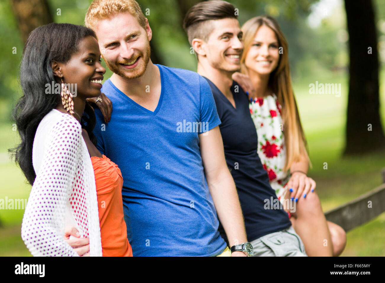 Group of happy young people in summer - Stock Image