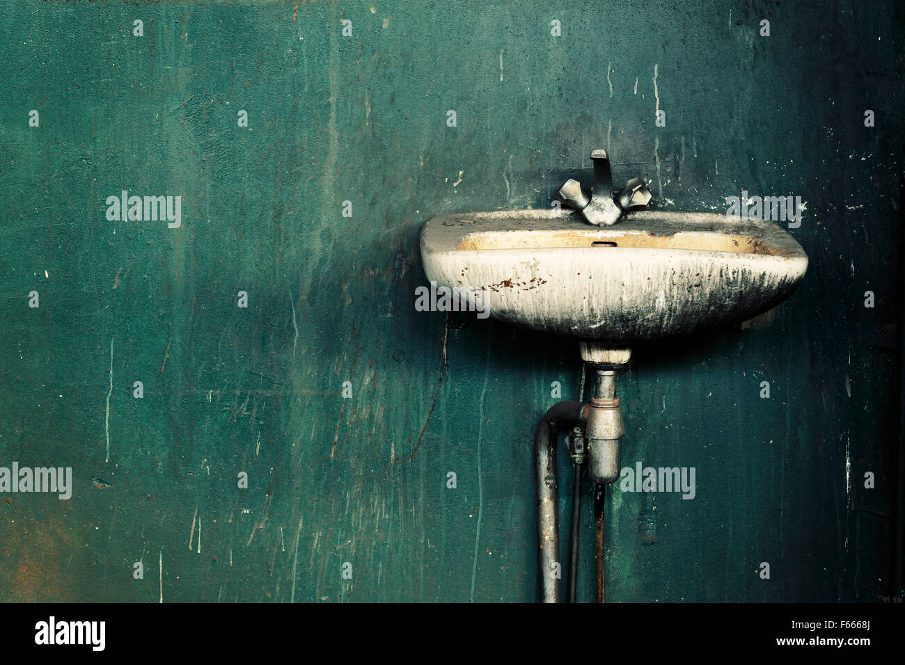 Old dirty sink in an abandoned factory. - Stock Image