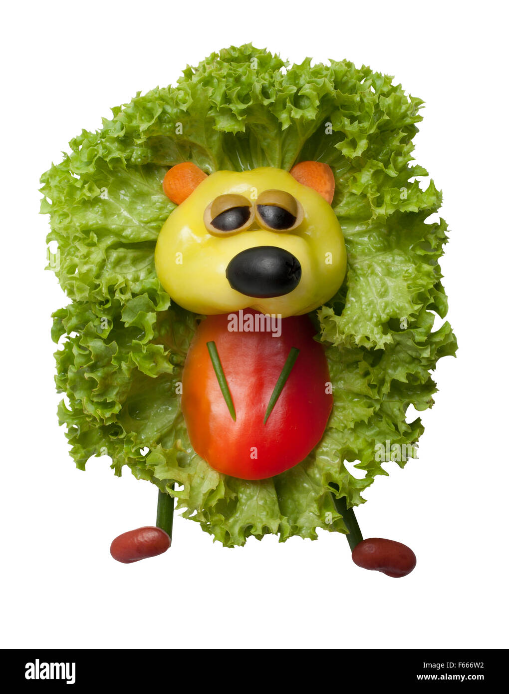 Funny hedgehog made of pepper and salad - Stock Image