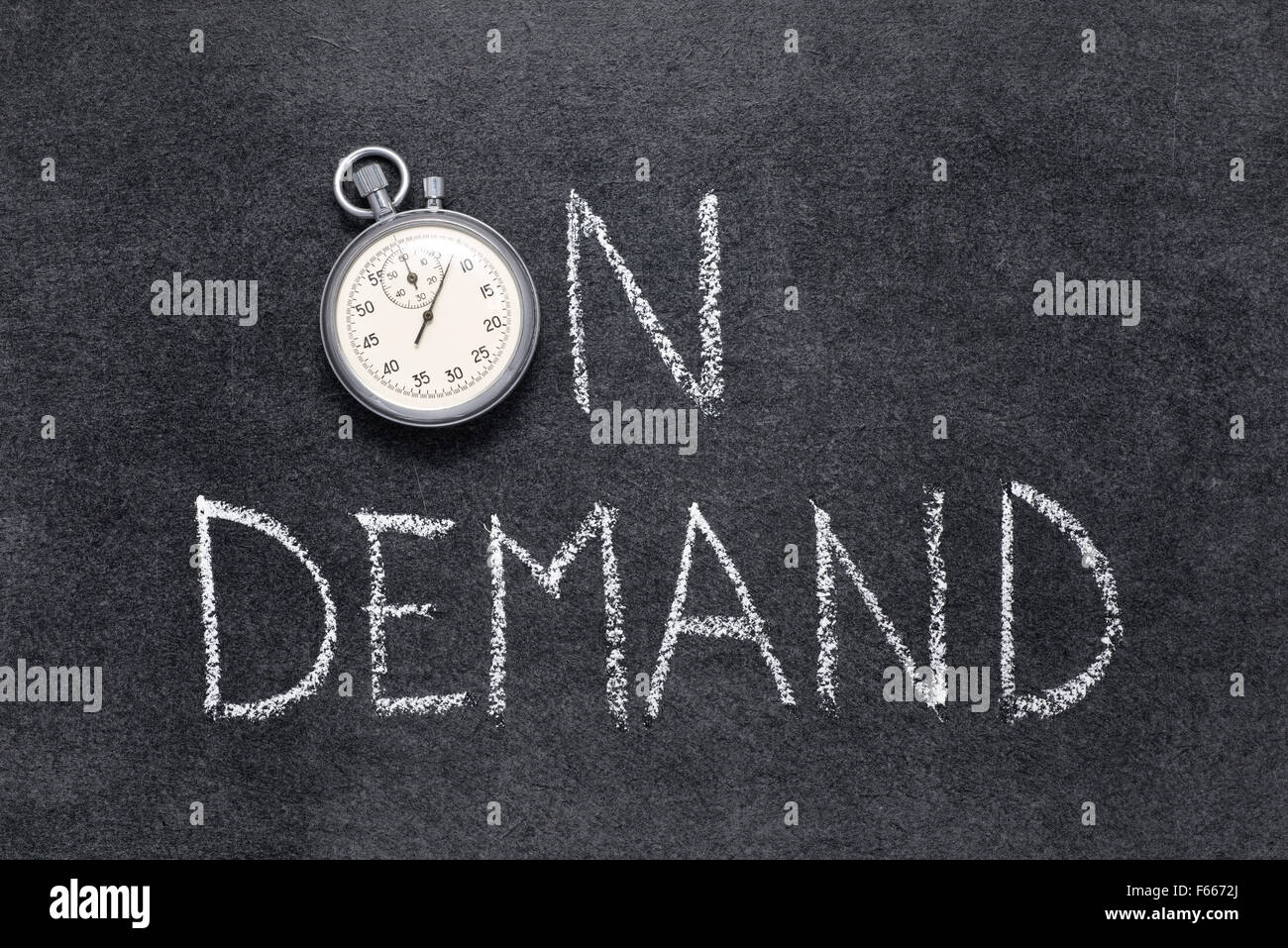 on demand phrase handwritten on chalkboard with vintage precise stopwatch used instead of O - Stock Image