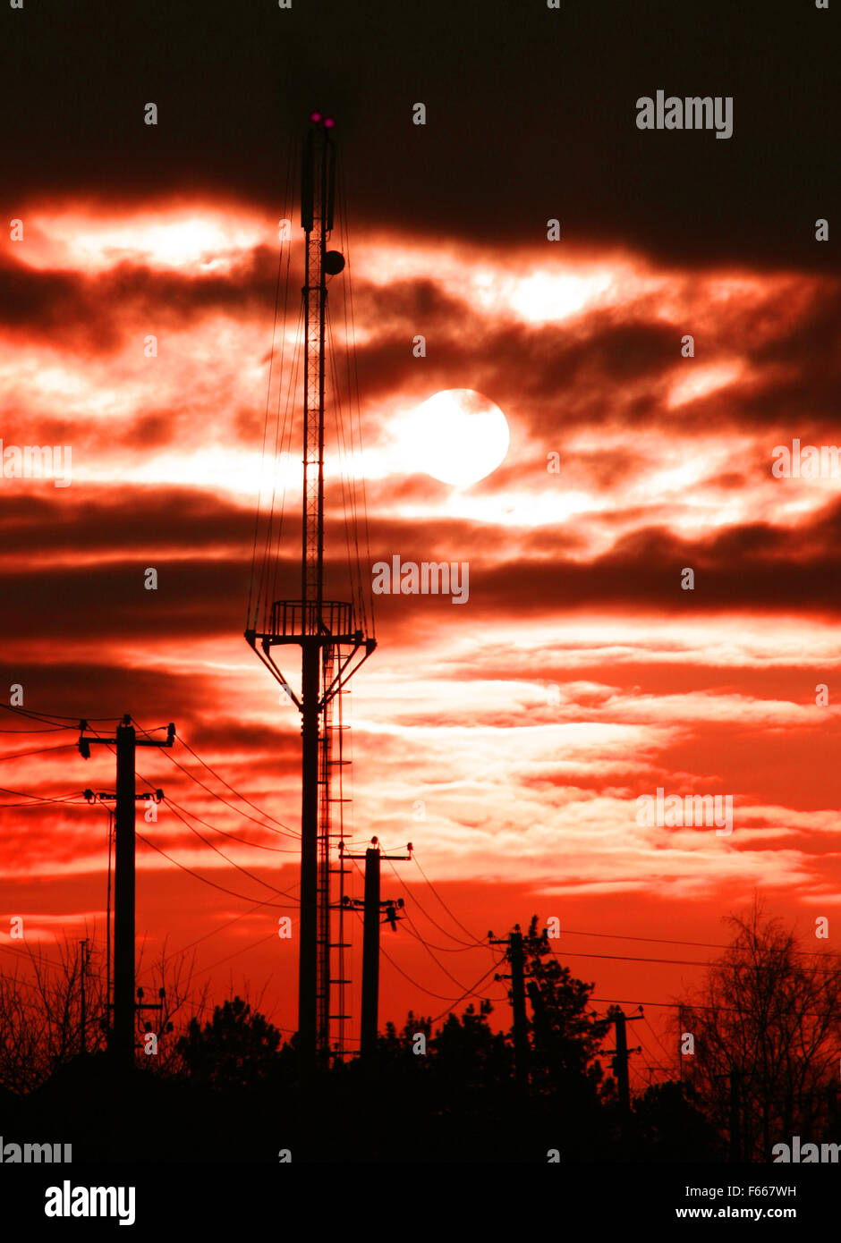Mobile aerial at dramatic sunset - Stock Image