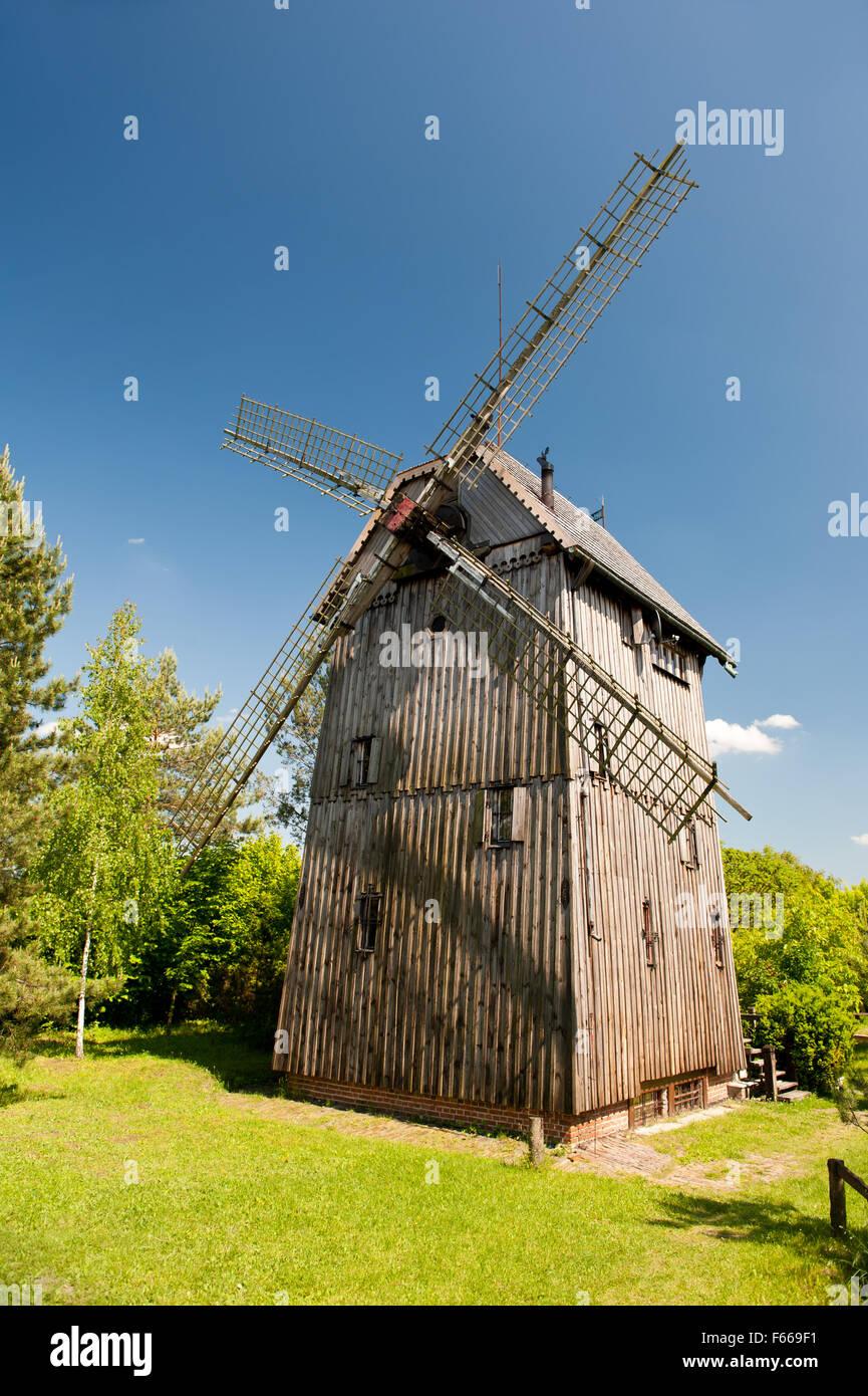 Old wooden windmill building with blades in Mecmierz, Poland, Polish name drewniany wiatrak Kozlak, Wiatrak Trzech - Stock Image