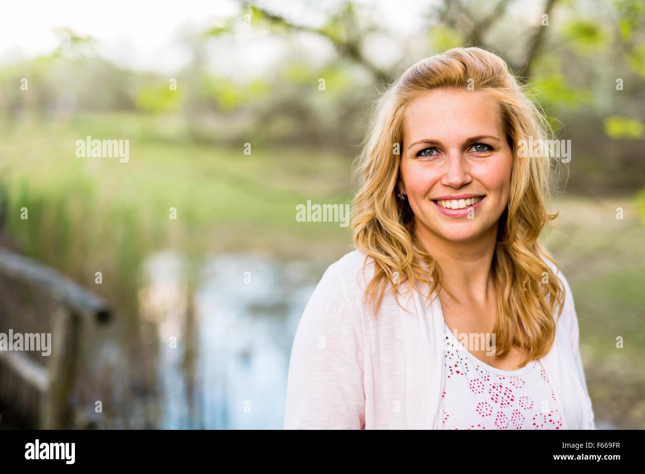 Beautiful blonde woman in nature - Stock Image