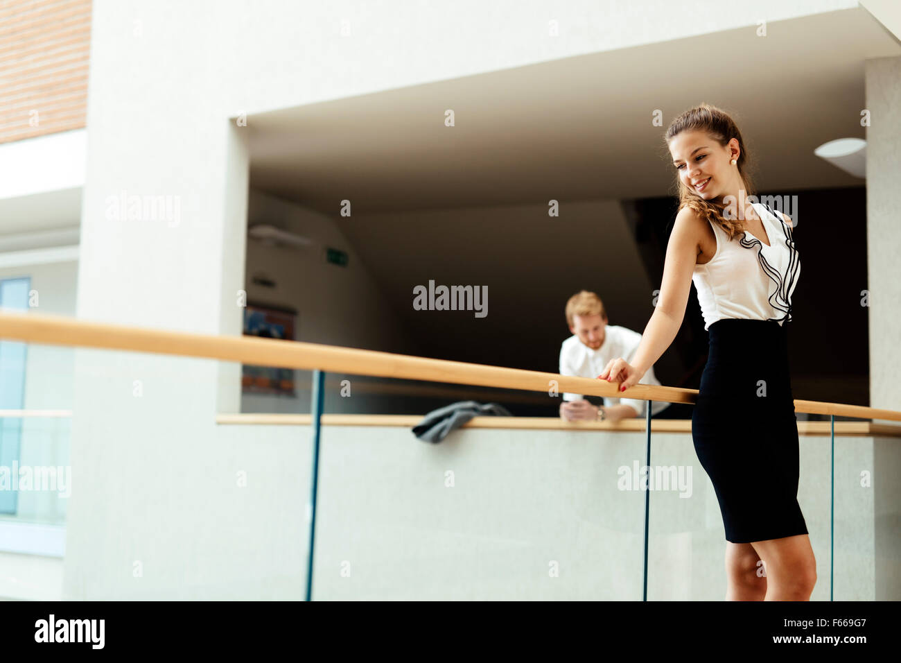 Beautiful businesswoman and her colleague - Stock Image