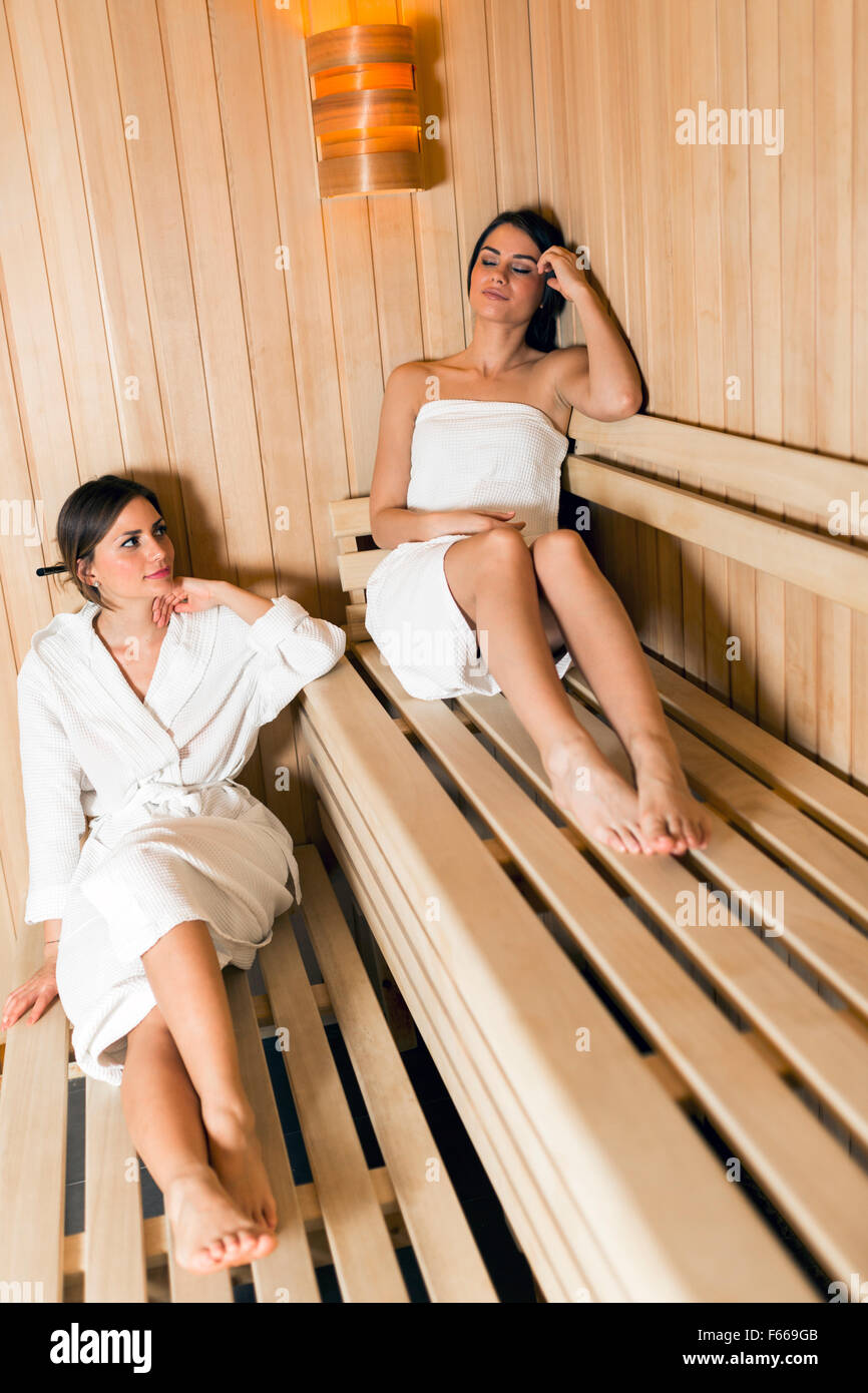 Two fit and beautiful women relaxing in a sauna - Stock Image