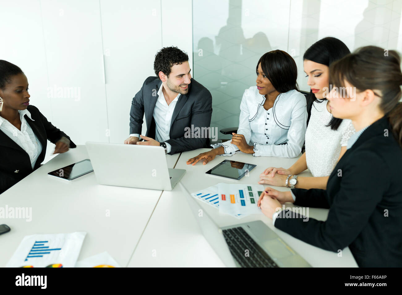 Business brainstorming and exchange of ideas by nicely dressed colleagues - Stock Image
