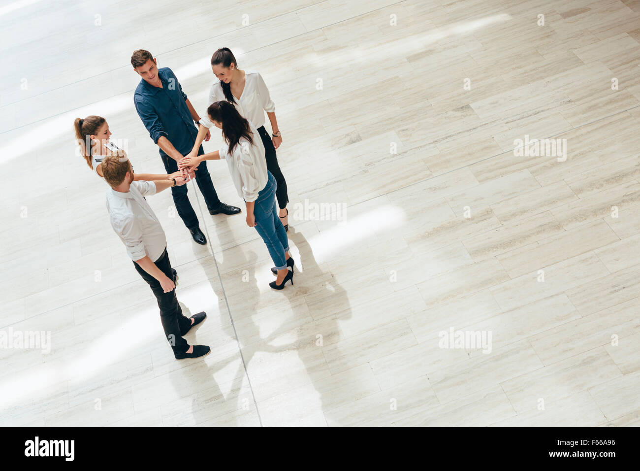 Business teamwork. People with joined hands. Union. Top View - Stock Image