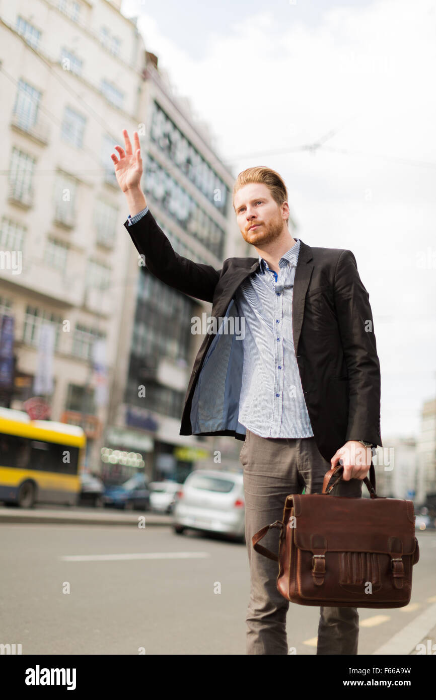 Budinessman trying to catch a cab - Stock Image