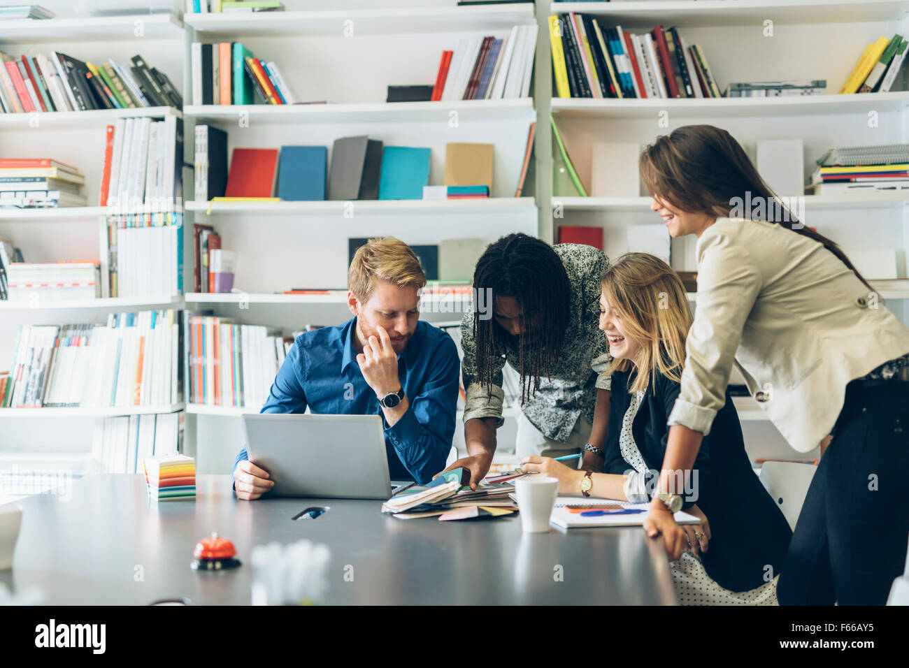 Brainstorming event between colleagues at work in office - Stock Image