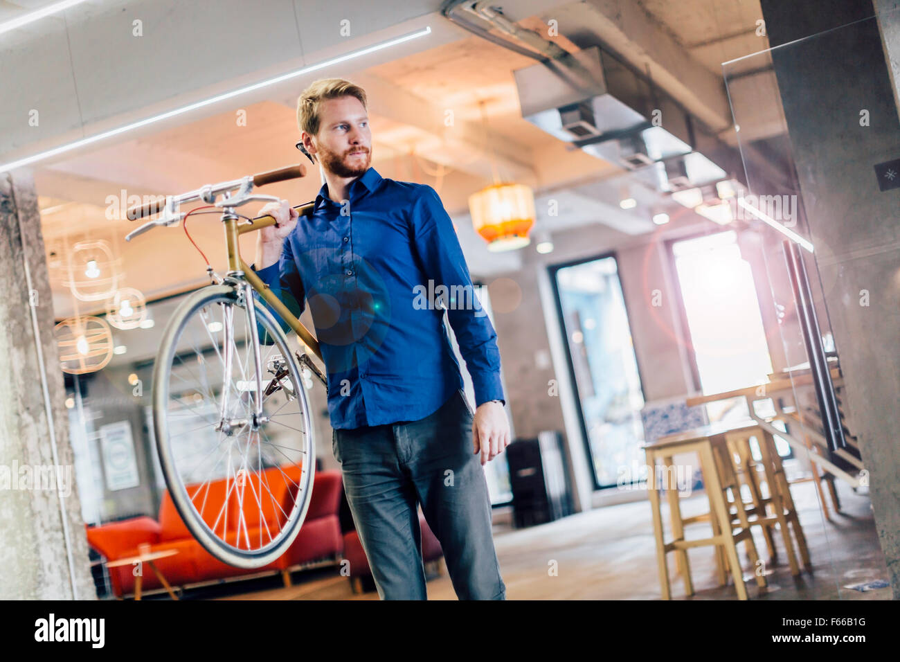 Using bicycle to go to work instead of polluting the environment. Green planet - Stock Image