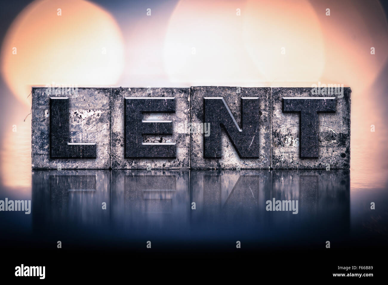 """The word """"LENT"""" written in vintage ink stained letterpress type. Stock Photo"""
