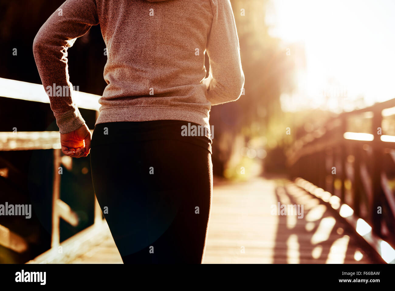 Beautiful female runner jogging in nature - Stock Image