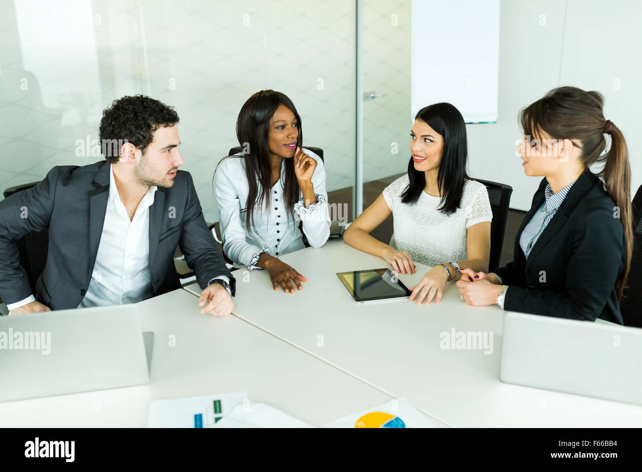 Business talk while sitting at a table and analyzing  results - Stock Image
