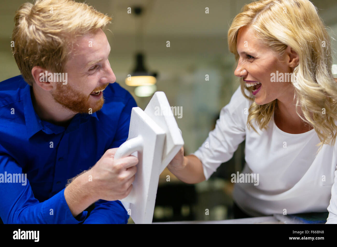 Collaboration and determination leads to success - Stock Image