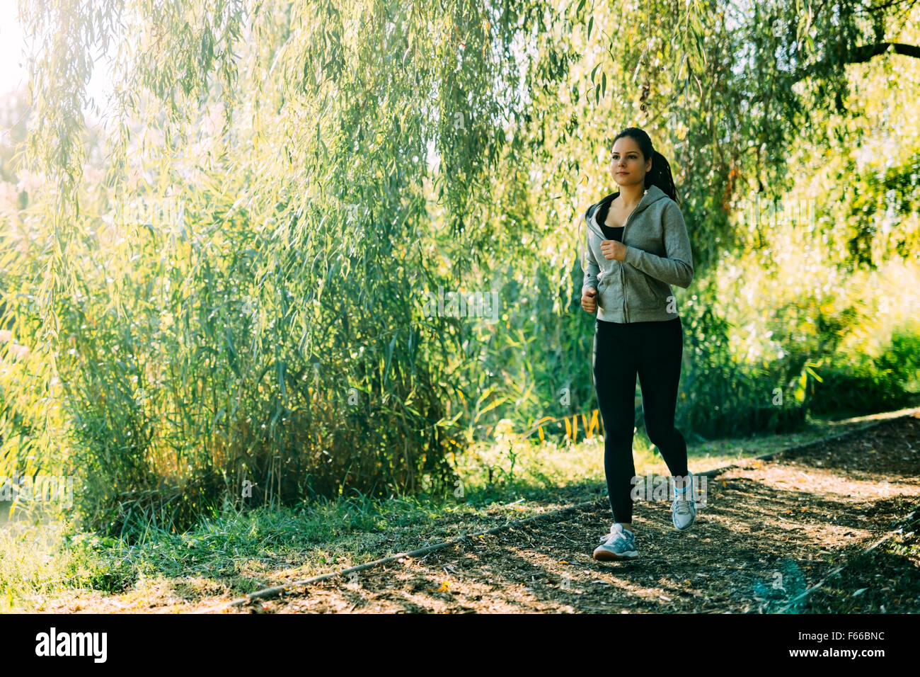 Fit woman jogging outdoors in nature Stock Photo