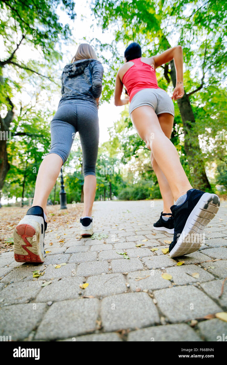 Women jogging in park and living a healthy sporty life - Stock Image