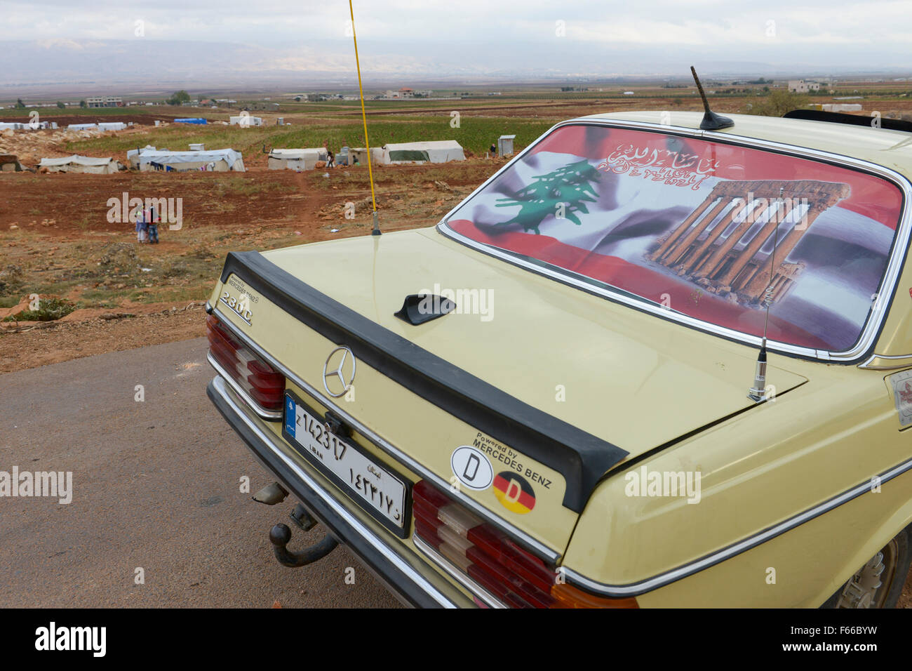 LEBANON Beqaa valley, Deir el Ahmad, camp for syrian refugees, old german Mercedes Benz car with german country - Stock Image