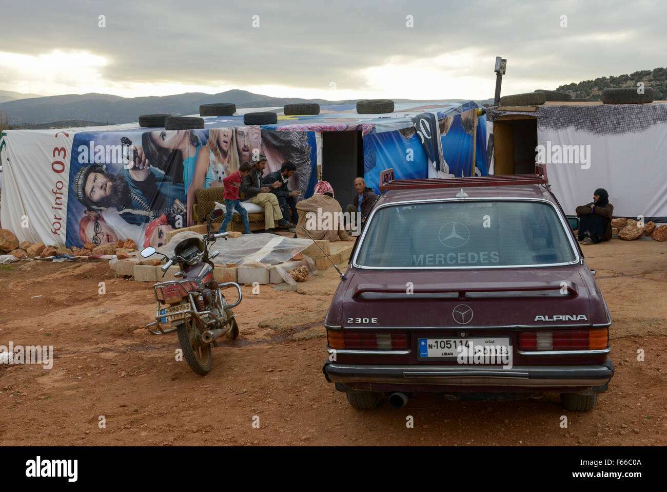 LEBANON Beqaa valley, Deir el Ahmad, camp for syrian refugees, family in tent made from old cinema poster, in front - Stock Image