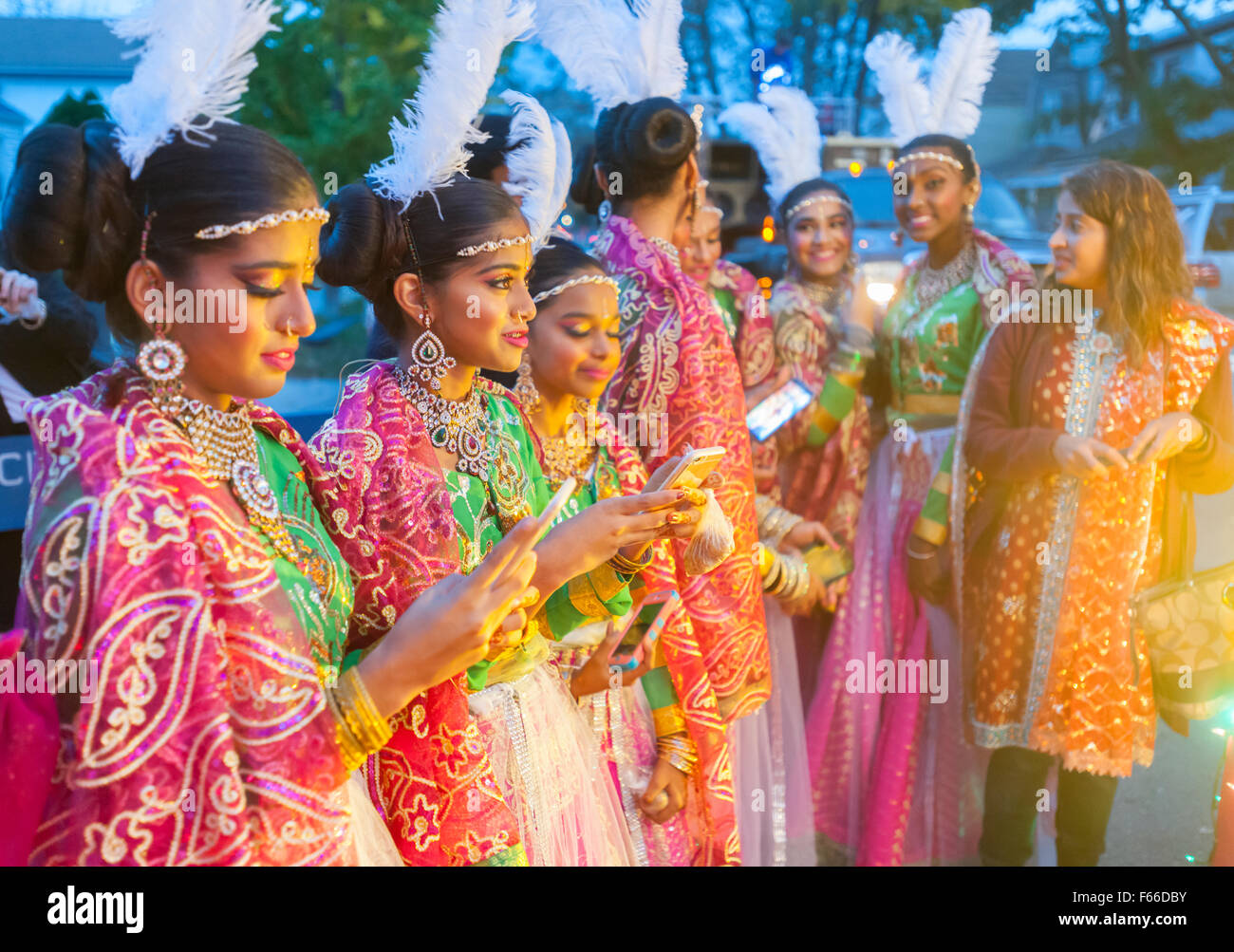 Teen and tween participants prepare for the Diwali Motorcade down Liberty Avenue in the Richmond Hill neighborhood - Stock Image