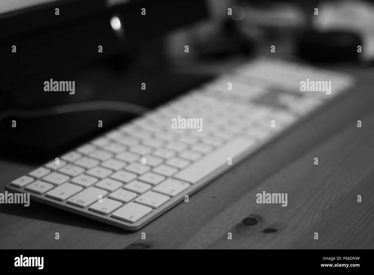 Keyboard on a desk with blurred background - Stock Image