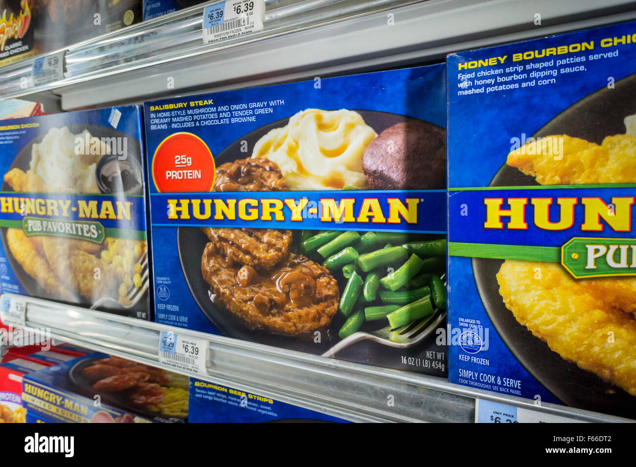 Hungry-Man brand tv dinners in a supermarket freezer in New York on Tuesday, November 10, 2015. With consumers preferences - Stock Image