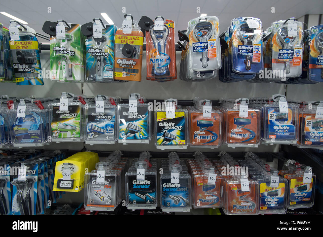 Mens razor blades for sale on a shelf in a supermarket. - Stock Image