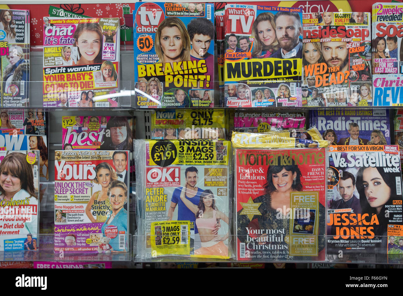 Celebrity and womens magazines on sale on a rack in a newsagent store. - Stock Image