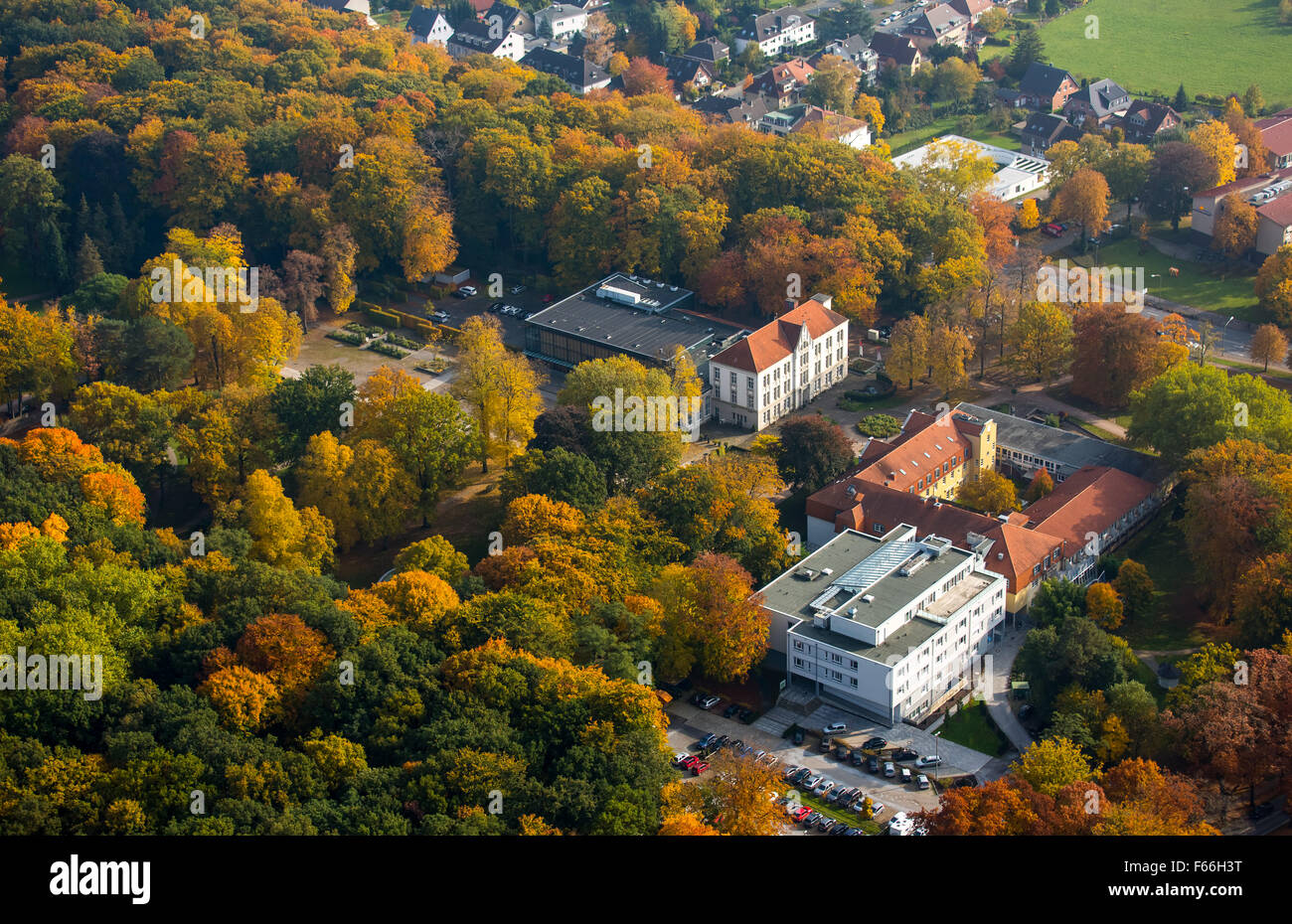 Clinic for Manual Therapy and Kurhaus Bad Hamm in autumn forest at Kurpark Hamm, Hamm Ruhr Nordrhein-Westfalen Germany - Stock Image