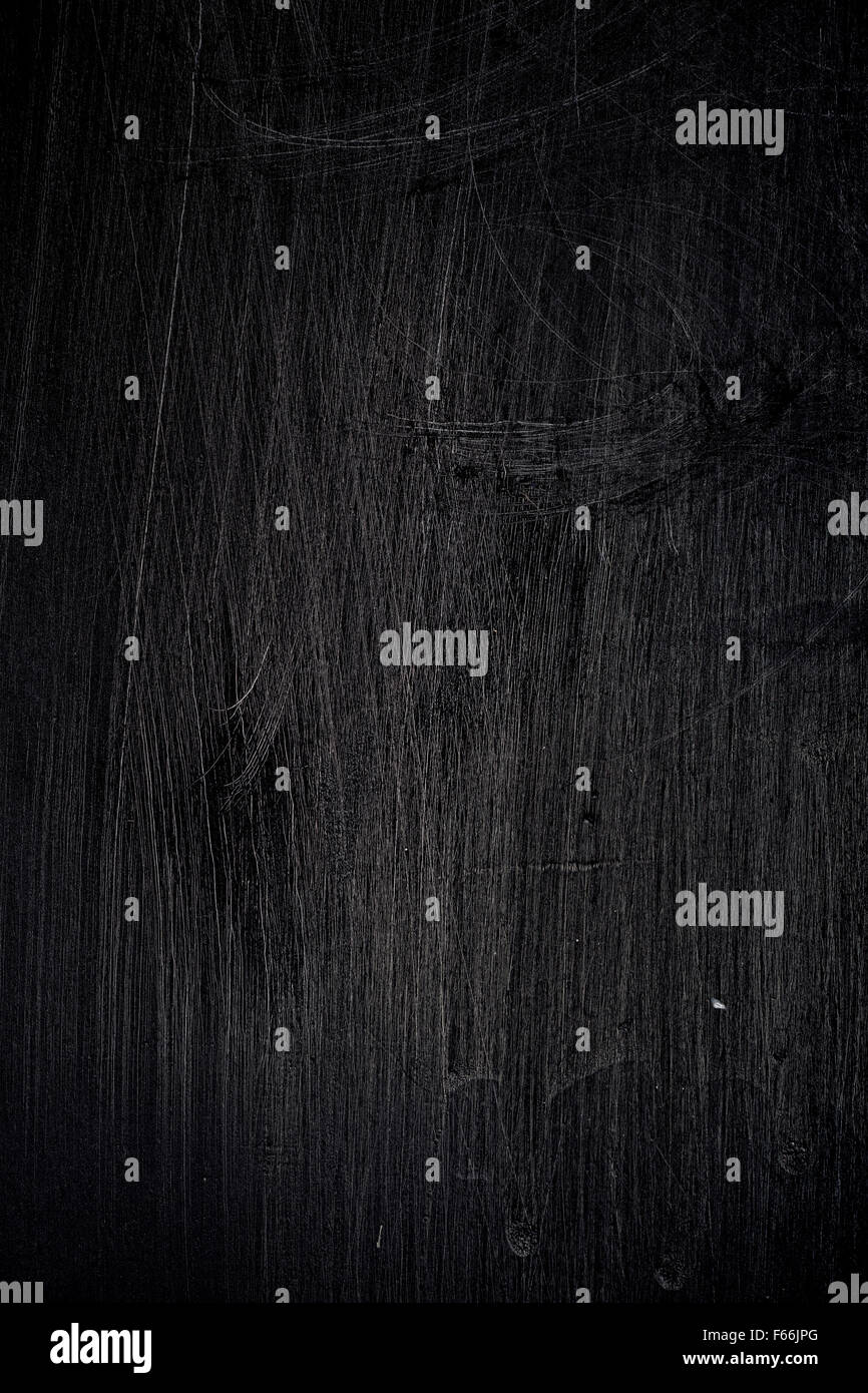 scratched black background - Stock Image
