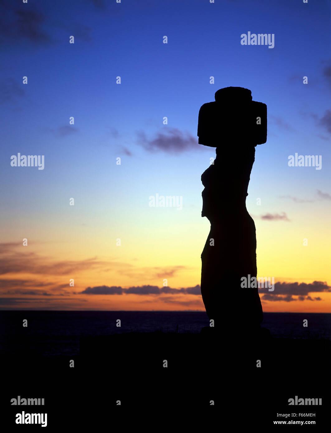 Easter Island, Sunset Behind Statue Ahu Ko Te Riku - Stock Image