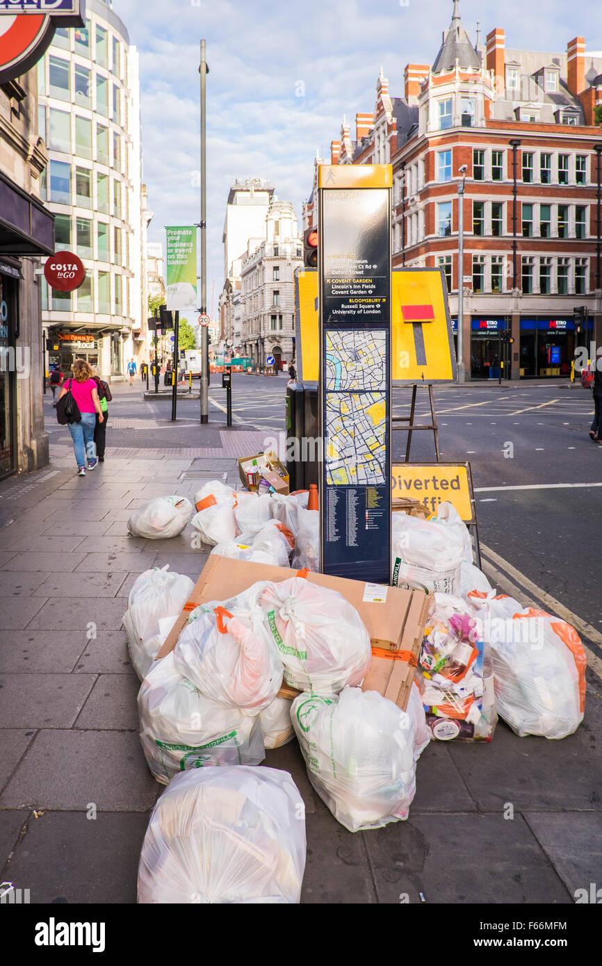 Rubbish bags on the street, London, England, U.K. - Stock Image