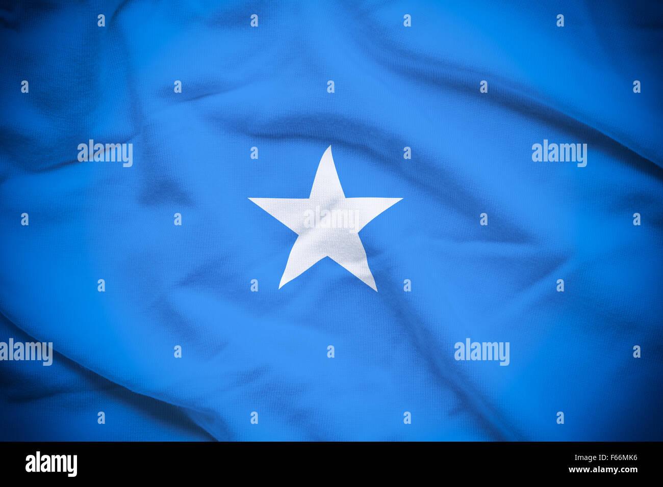 Wavy and rippled national flag of Somalia background. Stock Photo