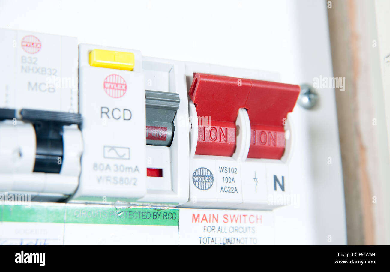 Domestic home electrics main fuse box with on off switch UK - Stock Image