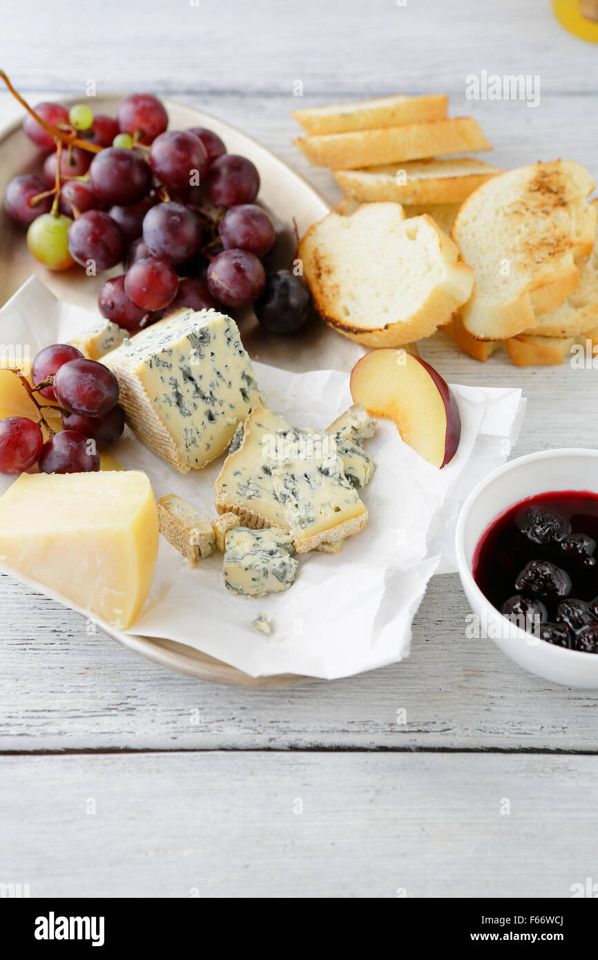 roquefort cheese with jam and grapes, food close-up - Stock Image