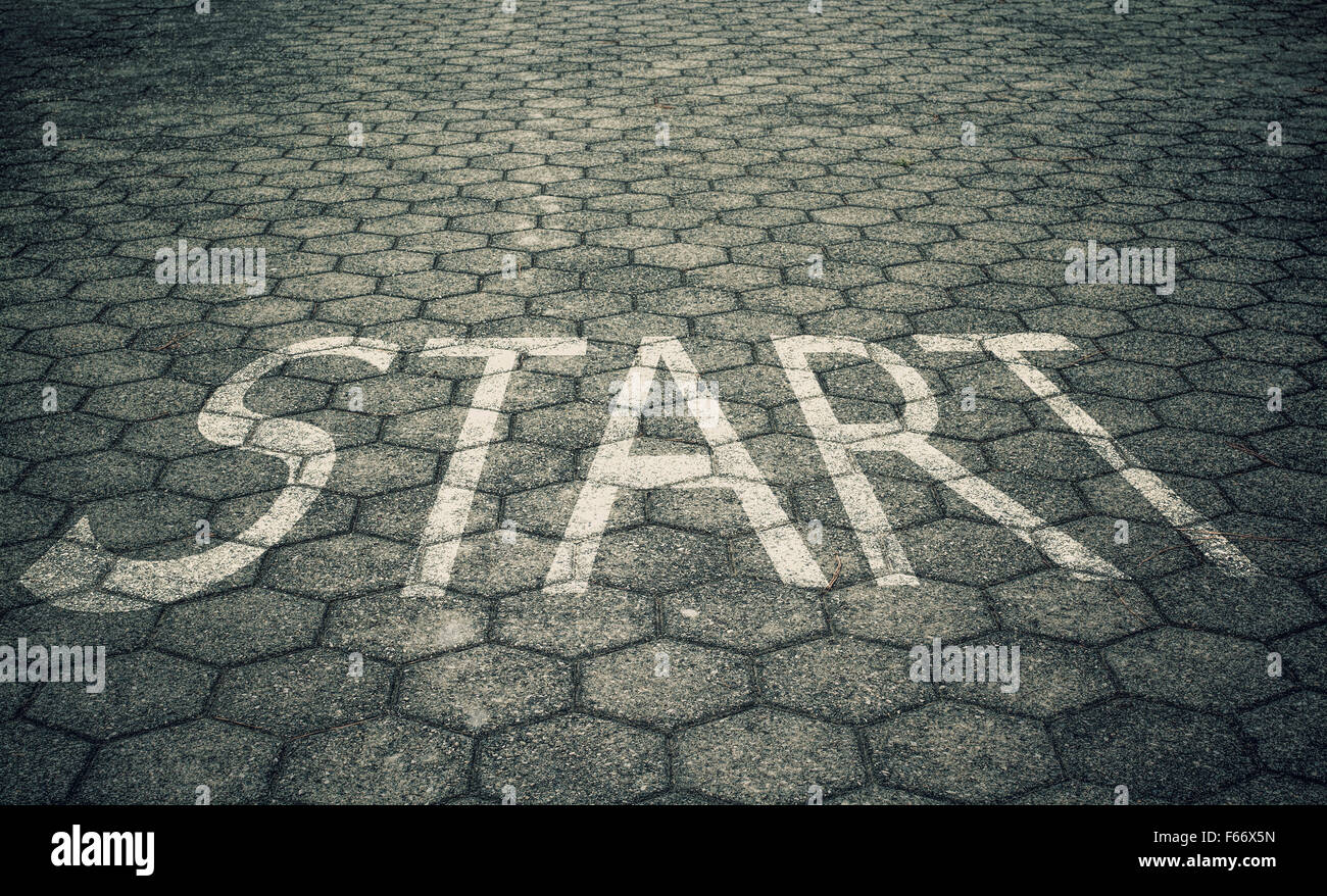 Start text on floor - Stock Image